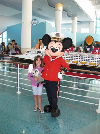 Captain Mickey greeting guests at the DCL Terminal